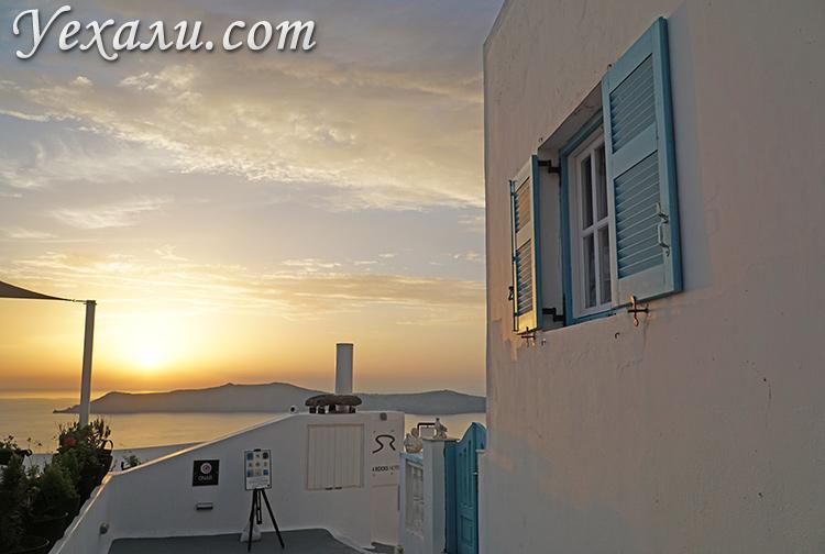 Лучшие фото города Фира на Санторини, Греция: закат над Кальдерой вулкана.