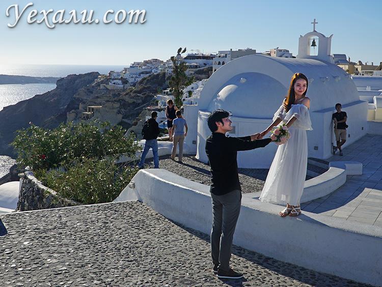 Лучшие фото Ойи, остров Санторини, Греция: свадьба туристов.